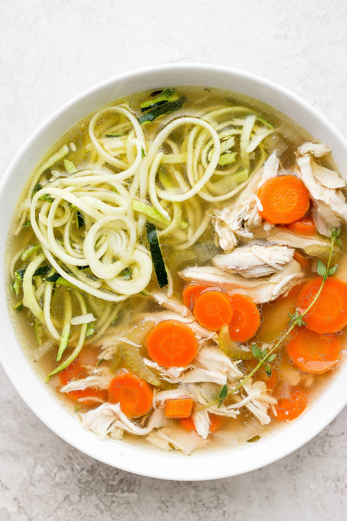A bowl of chicken soup with zoodles.