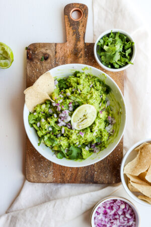 Fresh Homemade Guacamole with Tomatoes, Onion and Garlic - a light and refreshing guacamole recipe that goes with almost anything! #whole30 #guacamole #summerfood