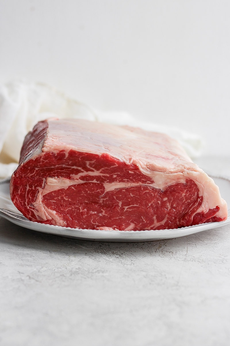 Raw prime rib on a plate.
