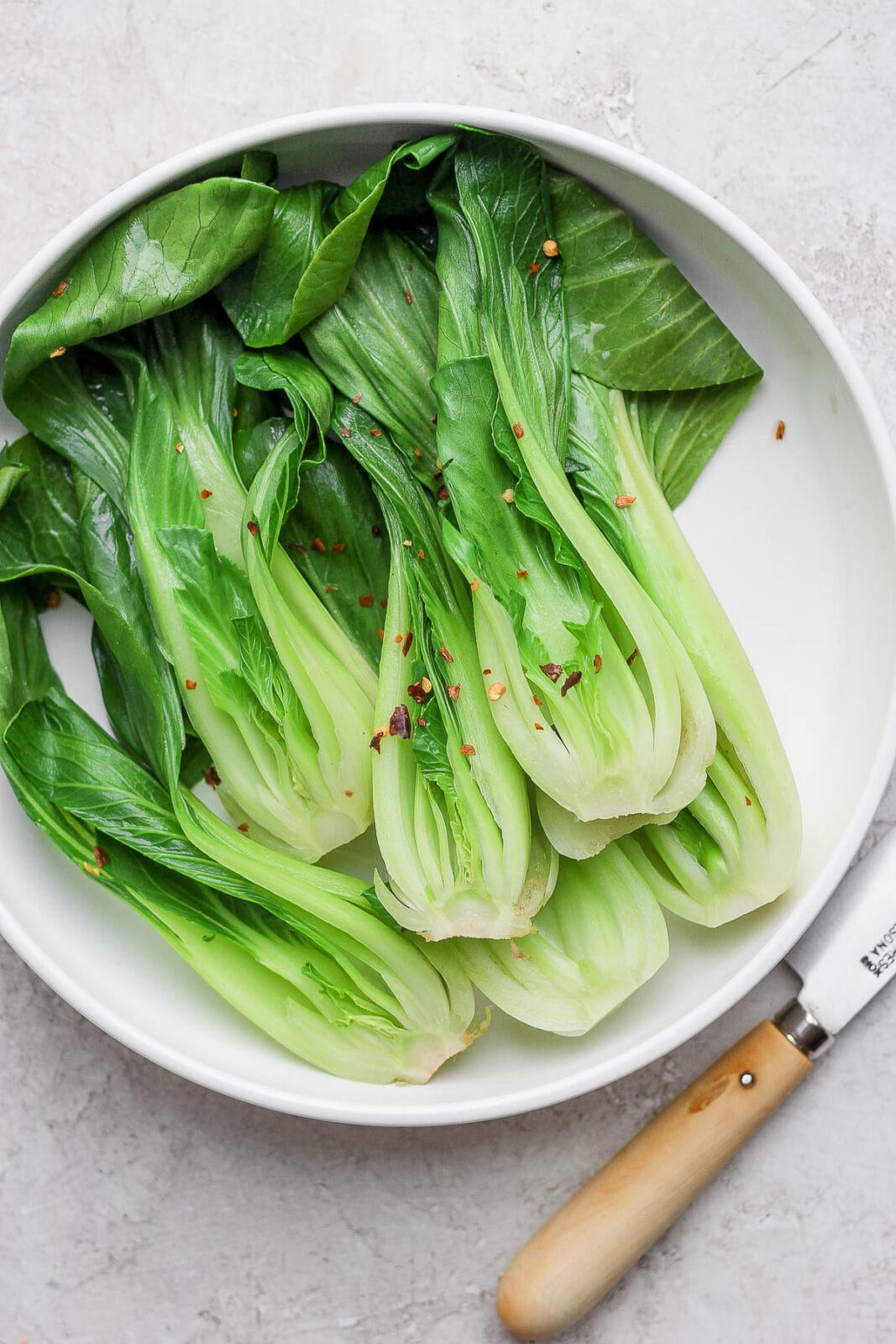 Cooked bok choy on a plate.