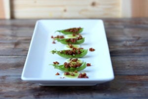 Spanish Chorizo and Leek Stuffed Pea Pods - thewoodenskillet.com #appetizer