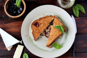 Baked Brie Grilled Cheese with Sweet Basil - thewoodenskillet.com #grilledcheese #meatless