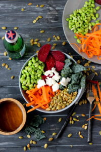 Raw Summer Salad with Beets, Carrot, Edamame, Pumpkin Seeds, Kale and Goat Cheese with Honey Viniagrette - thewoodenskillet.com