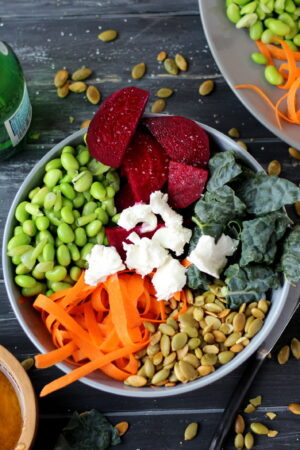 Raw Summer Salad with Beets, Kale, Pumpkin Seeds, Carrots, Edamame and Goat Cheese with Honey Viniagrette - thewoodenskillet.com