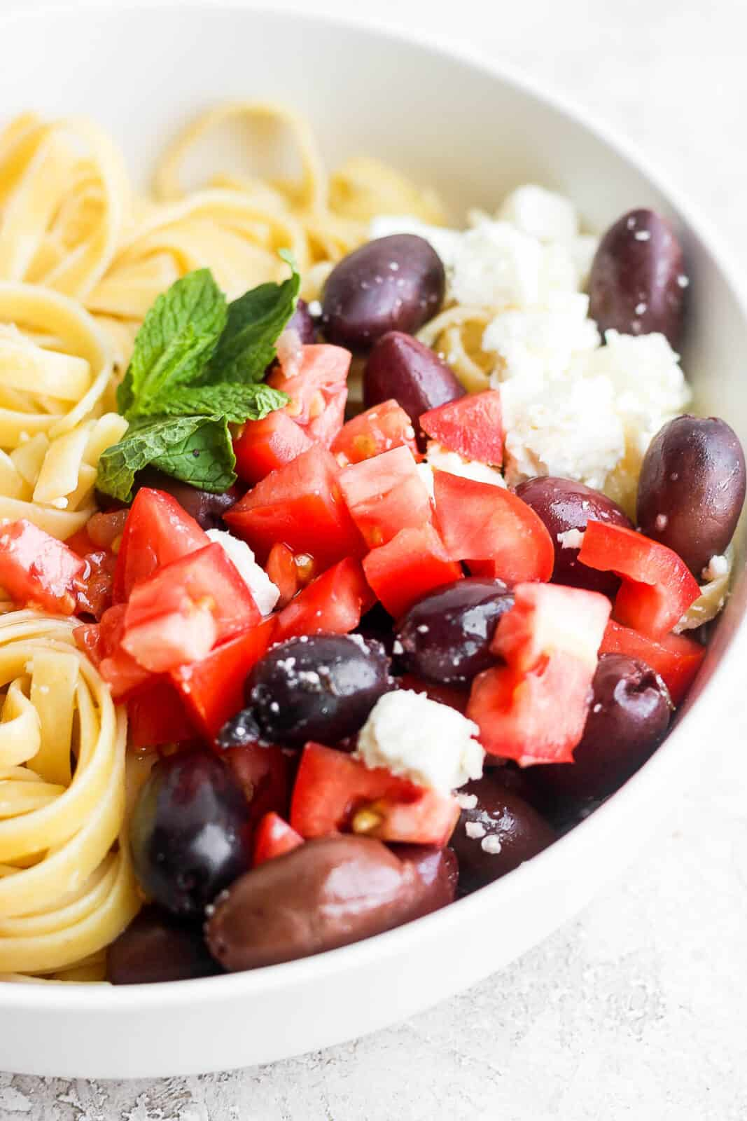 Side view of bowl of Greek Pasta.