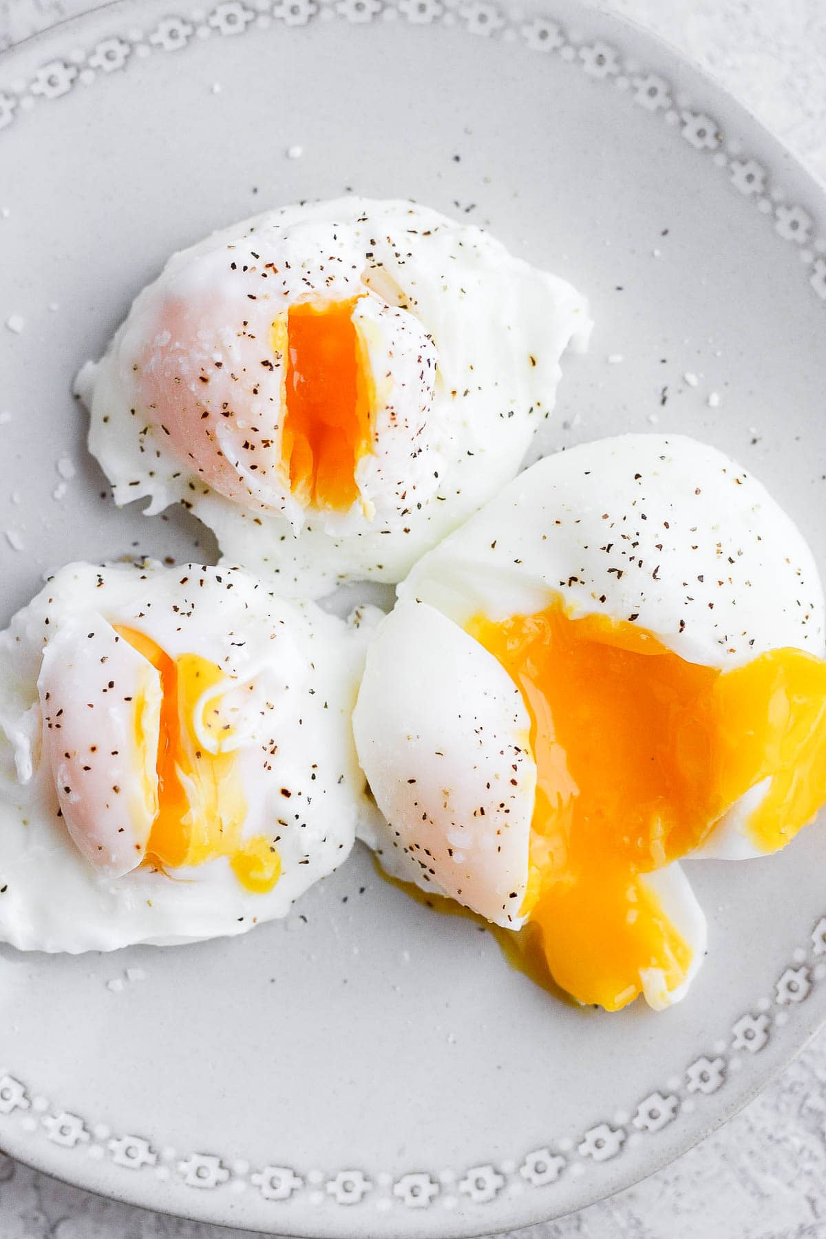 Three poached eggs on a plate.