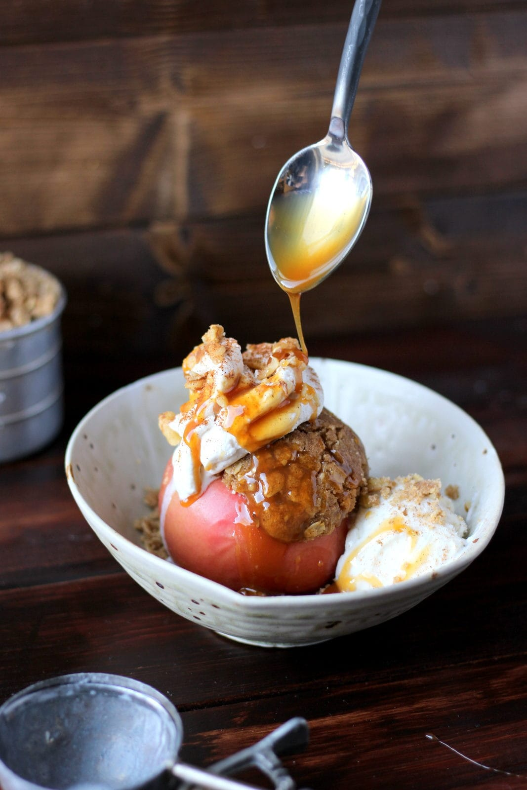 Stuffed Apples + Cardamom Whipped Cream and Vanilla Bean Ice Cream topped with Walnuts and Caramel Sauce. The perfect dessert for fall! Includes instructions on how to make homemade whipped cream! thewoodenskillet.com #foodphotography #foodstyling