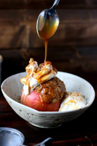 Stuffed Apples + Cardamom Whipped Cream and Vanilla Bean Ice Cream topped with Walnuts and Caramel Sauce. The perfect dessert for fall! Includes instructions on how to make homemade whipped cream! thewoodenskillet.com #foodphotography #foodstyling #apples