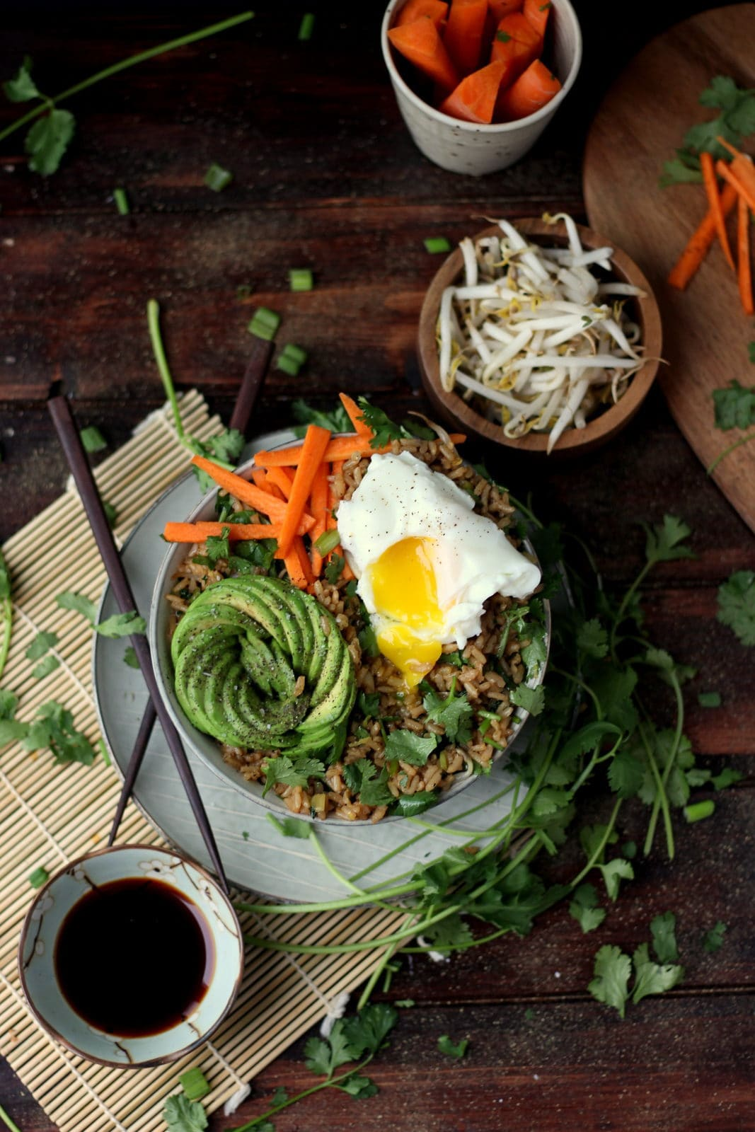 Cilantro Fried Rice + Avocado and Poached Egg - awesome vegetarian rice bowl recipe! thewoodenskillet.com #foodstyling #foodphotography