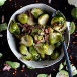 Roasted Brussel Sprouts + Pancetta and Red Pepper Flakes - savory side dish for Christmas or any meal! thewoodenskillet.com #christmasrecipe