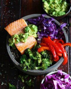 Salmon Power Bowl + Roasted Vegetables and Avocado - a healthy and delicious bowl of nutrients perfect for lunch or dinner. thewoodenskillet.com