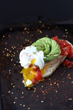 Spicy Avocado Toast + Roasted Tomatoes and Poached Egg - thewoodenskillet.com