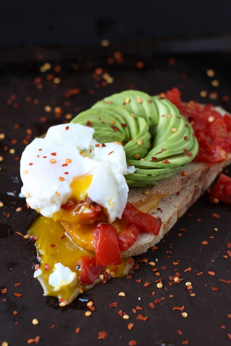Spicy Avocado Toast + Roasted Tomatoes and Poached Egg. thewoodenskilelt.com