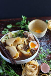 Thick Cut Homemade Noodles with bone broth, braised baby bok choy, mushrooms and soft-boiled egg. thewoodenskillet.com