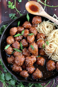 Sesame Soy Ginger Meatballs + Noodles. Easy to make meatball recipe, baked in a soy ginger sauce. thewoodenskillet.com