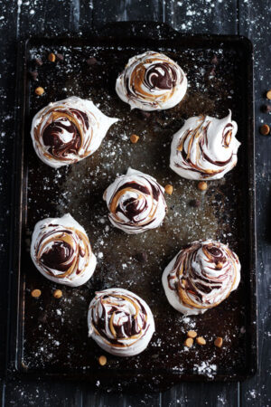 Peanut Butter and Chocolate Meringues - light and fluffy meringues, with pillow-soft insides, and swirled peanut butter and chocolate. thewoodenskillet.com #foodphotography