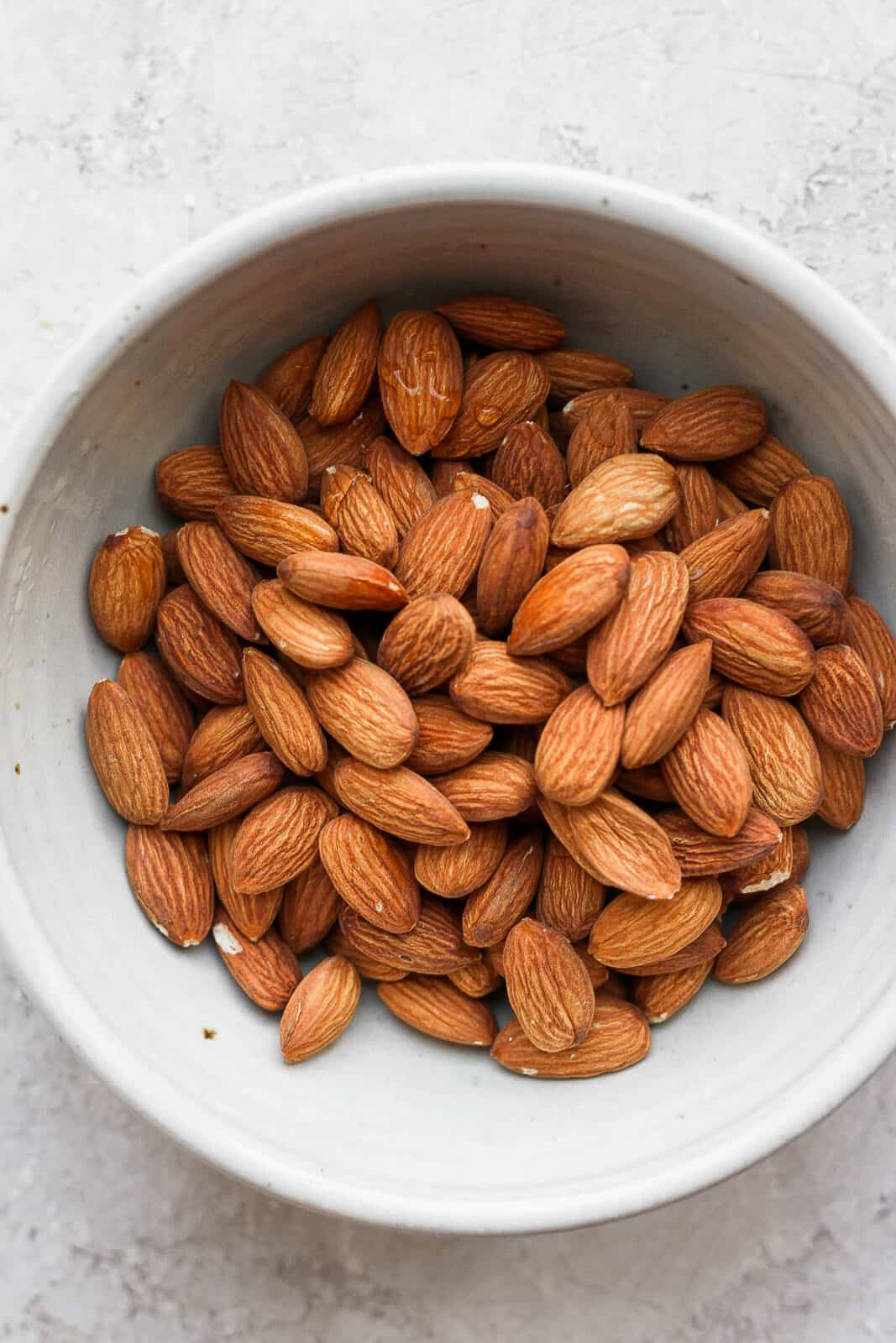 Raw almonds in a bowl.