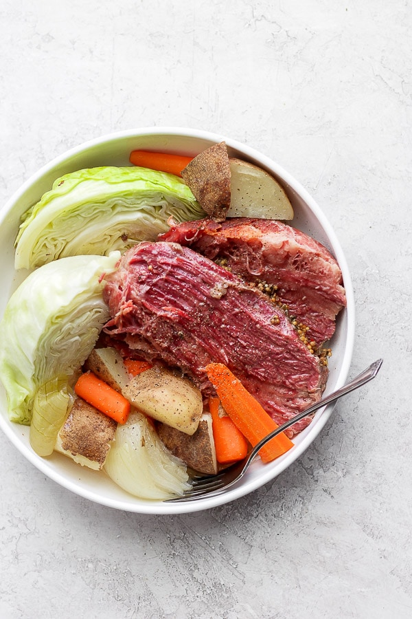 Bowl filled with corned beef and cabbage.