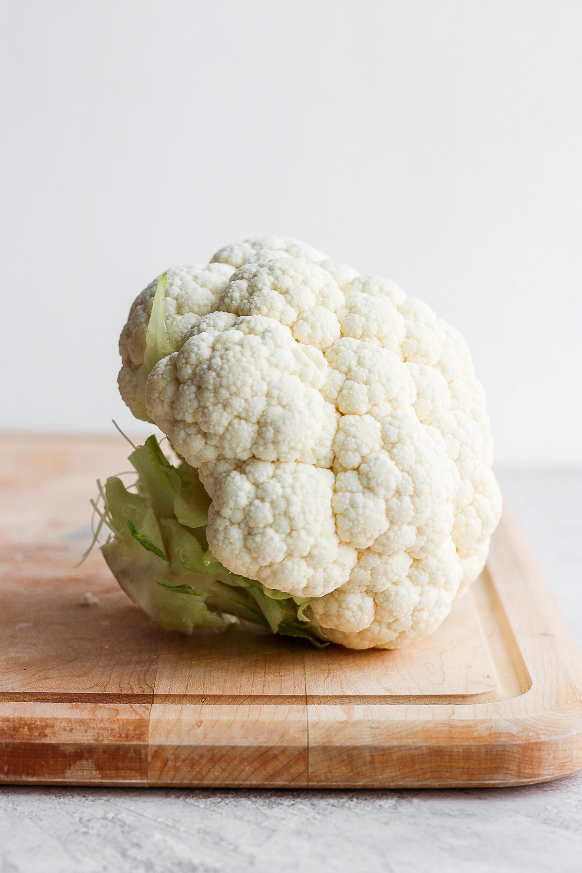 Head of cauliflower with leaves removed.