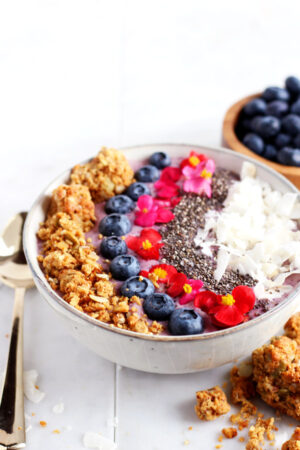 Coconut Blueberry Smoothie Bowl + Chia Seeds. A light, vegan breakfast that will keep you energized all morning long! thewoodenskillet.com