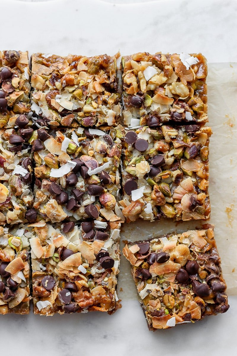 Cooked seven layer bars cut into squares.