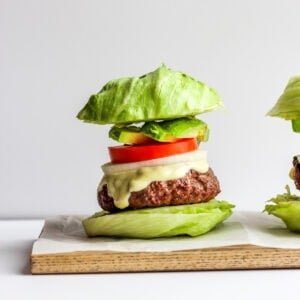 Amazing Whole30 Garlic Burgers - garlic-stuffed burgers that are so easy to make and will become a family favorite! #whole30 #paleo