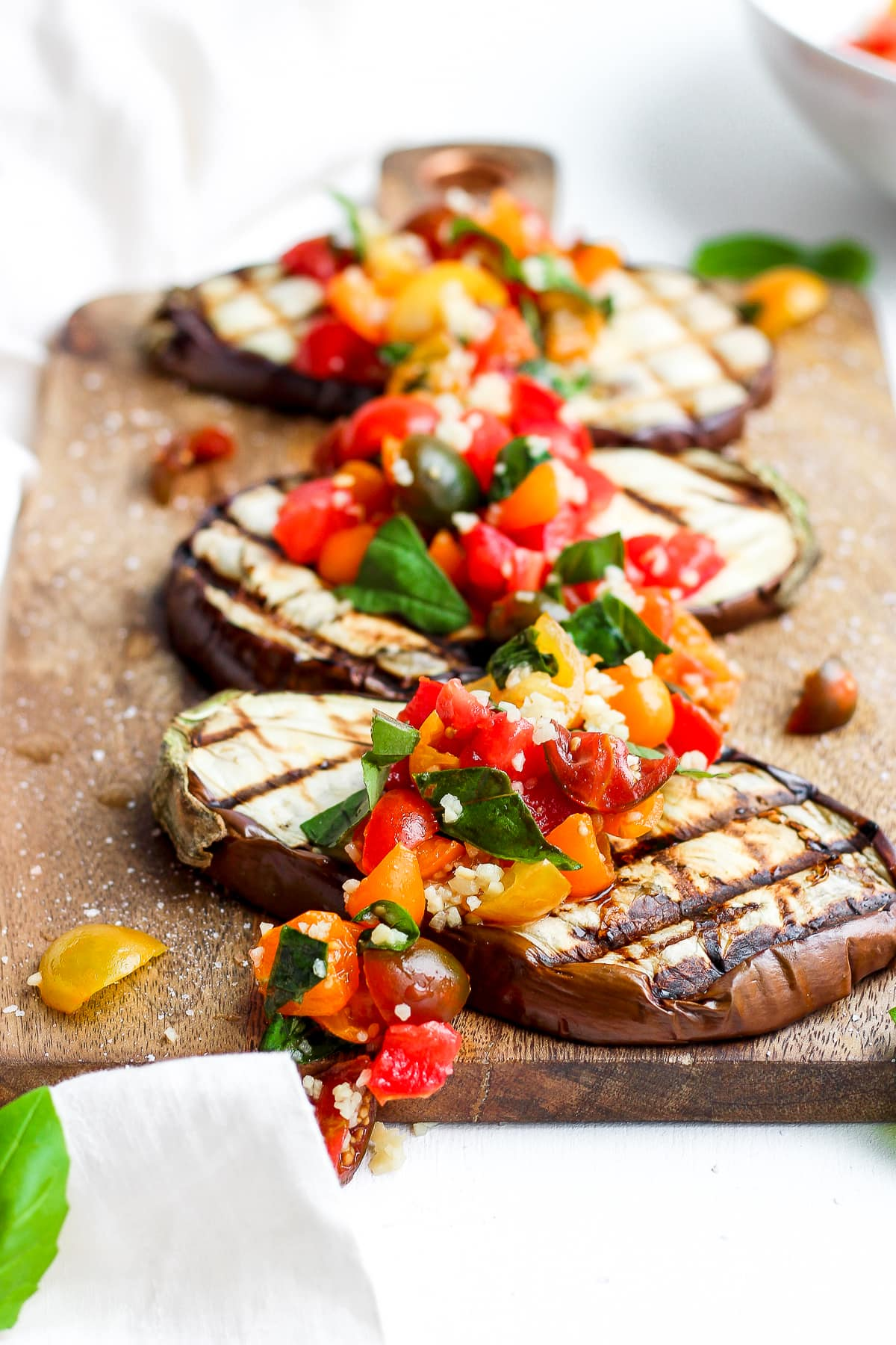 Eggplant Bruschetta on a wooden board.