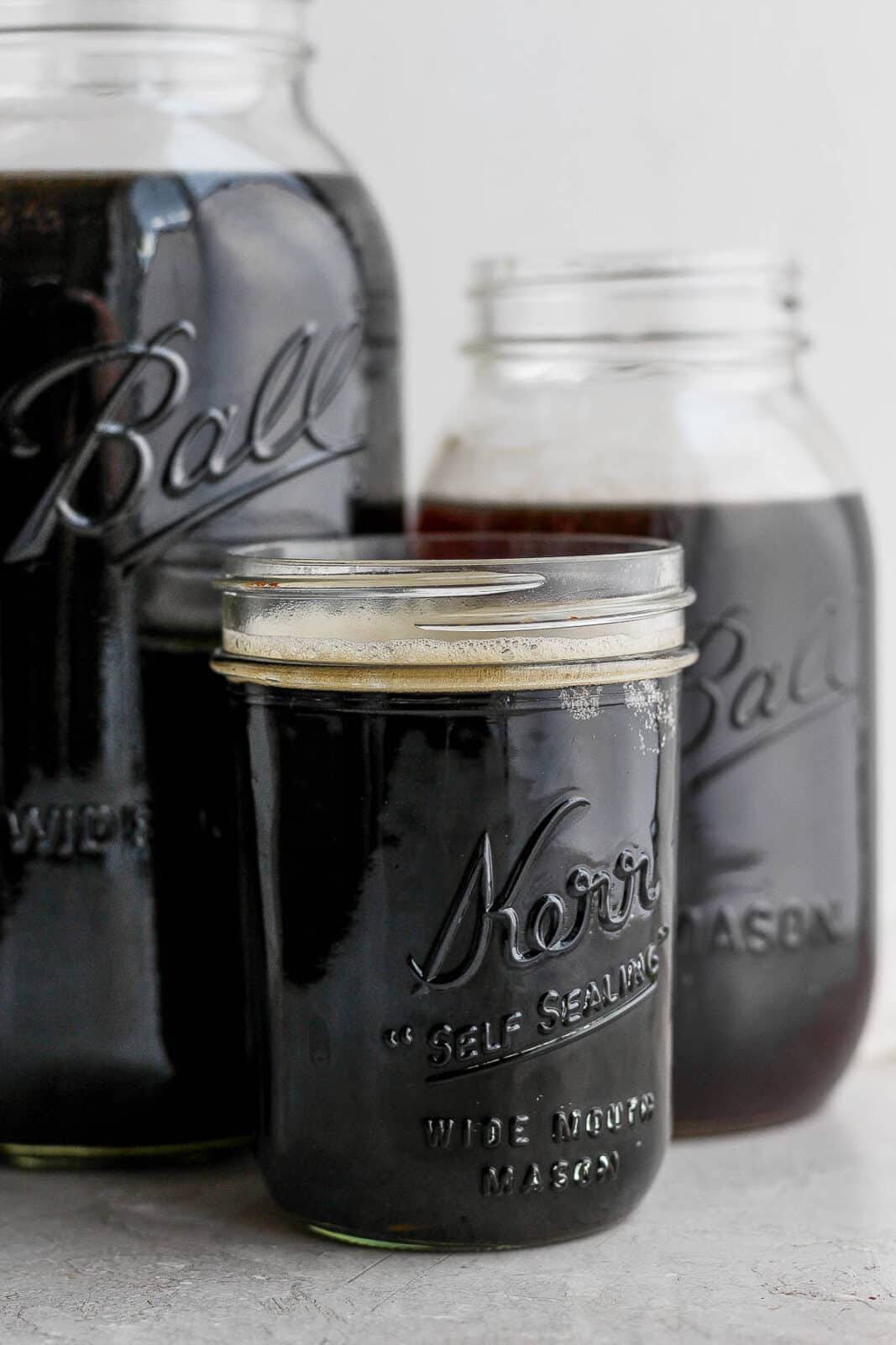 Three jars of cold brew coffee.