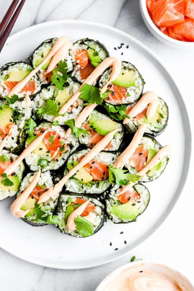 Spicy Salmon and Avocado Cauliflower Rice Sushi Roll.