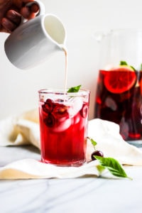 Delicious Hibiscus Cherry Iced Tea Cooler - a delicious and refreshing summer drink! #whole30 #paleo #vegan