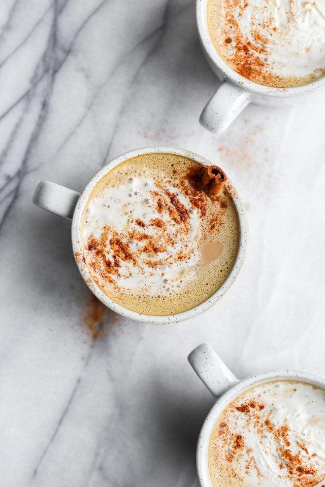 Three mugs of pumpkin spice latte.