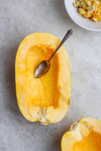 How to Roast Spaghetti Squash in the Oven - a step-by-step tutorial so your spaghetti squash turns out perfectly every time! #spaghettisquash #roastedspaghettisquash #howlongtocookspaghettisquash #roastedspaghettisquash #whole30recipe #paleorecipes
