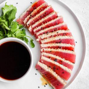 Simple Seared Ahi Tuna Recipe - all your seared ahi tuna questions answered PLUS a super simple recipes that is gluten-free, paleo and Whole30!! #whole30recipes #sushi #searedahitunarecipes #howtocooktuna #tunarecipes #tunasteak #paleorecipes #glutenfreerecipes #summerrecipes