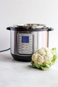 Instant Pot Cauliflower (Whole Cooked) - how to cook a whole head of cauliflower in the Instant Pot® (it's so easy). #instantpot #cauliflower #roastedcauliflower #instantpotcauliflower #plantbased #whole30 #paleo
