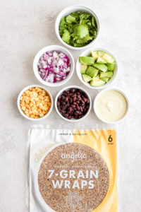 Easy Black Bean and Avocado Wrap - a quick and easy plant based meal you will love!!! #plantbased #wrap #blackbeanwrap #avocado #healthymealideas