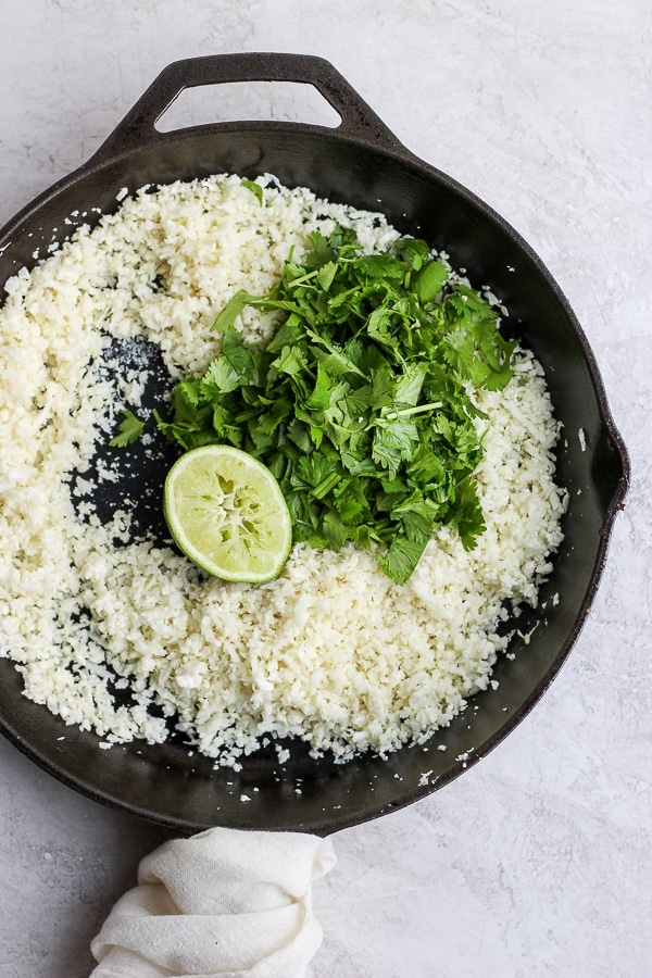 Cilantro Lime Cauliflower Rice in a cast iron skillet.