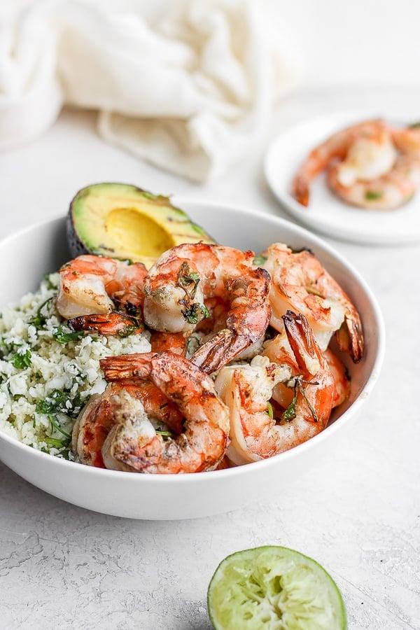 Bowl of cilantro lime cauliflower rice, grilled avocado and cilantro lime shrimp.