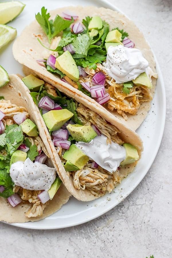salsa verde chicken tacos on a plate.