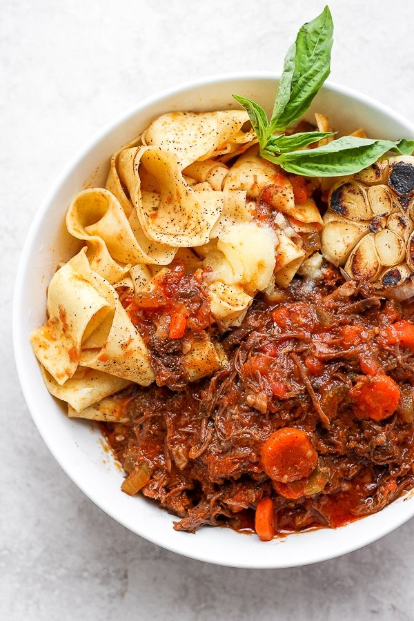 short rib ragu in a bowl with noodles.