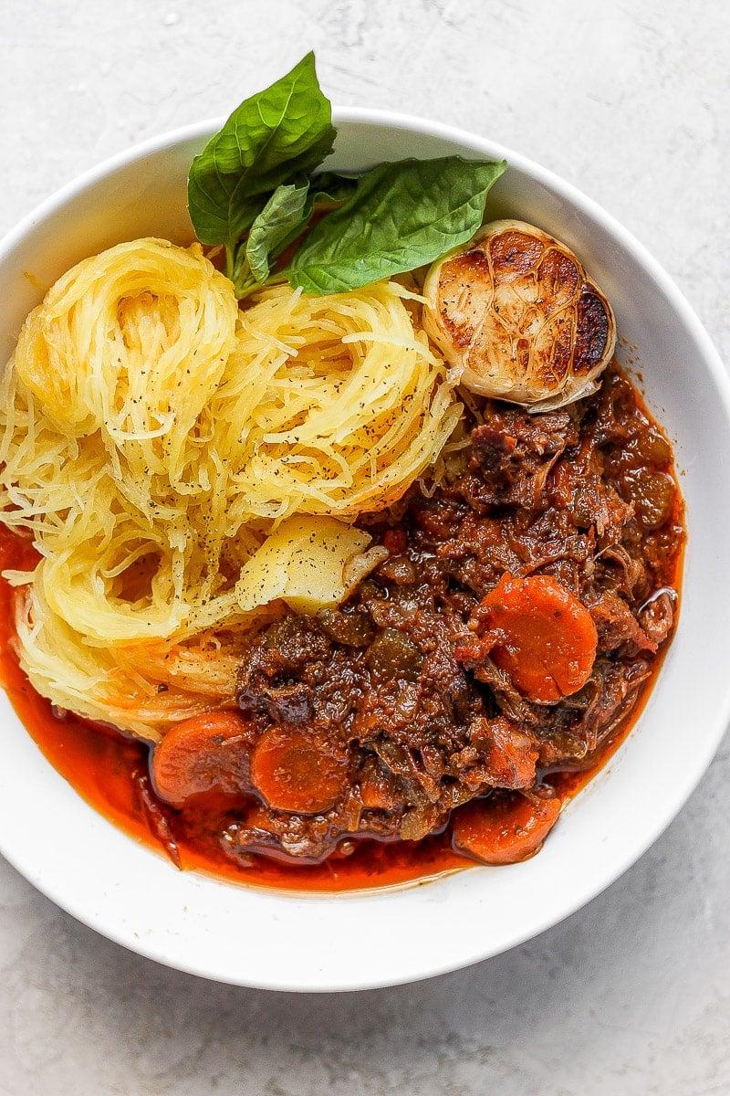 Short rib ragu in a bowl with spaghetti squash.