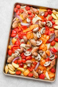 Sheet Pan Sausage and Veggies - the perfect weeknight meal! Easy, delicious and barely any clean-up! #sheetpanmeals #sheetpansausageandveggie #glutenfreemeals #easyweeknightmeals #whole30dinner #paleodinner