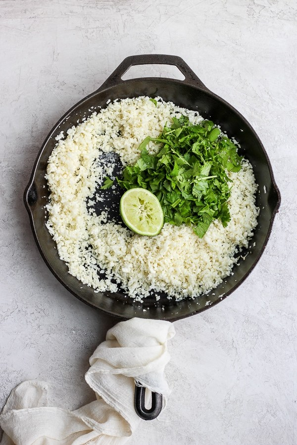 Cast iron skillet with cilantro lime cauliflower rice.