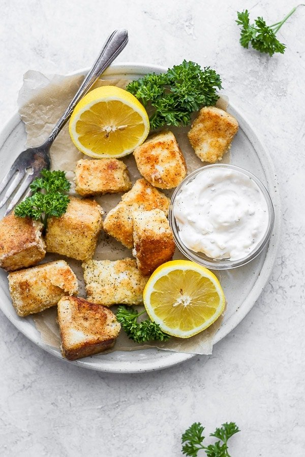 Healthy Baked Fish Nuggets - simple, real ingredients that come together easily to make the most delicious fish nuggets! (Paleo + Whole30 + GF + DF) #homemadefishnuggets #fishnuggets #howtomakefishnuggets #healthyfishnuggets #paleofishnuggets #whole30fishnuggets #whole30dinner #paleodinner