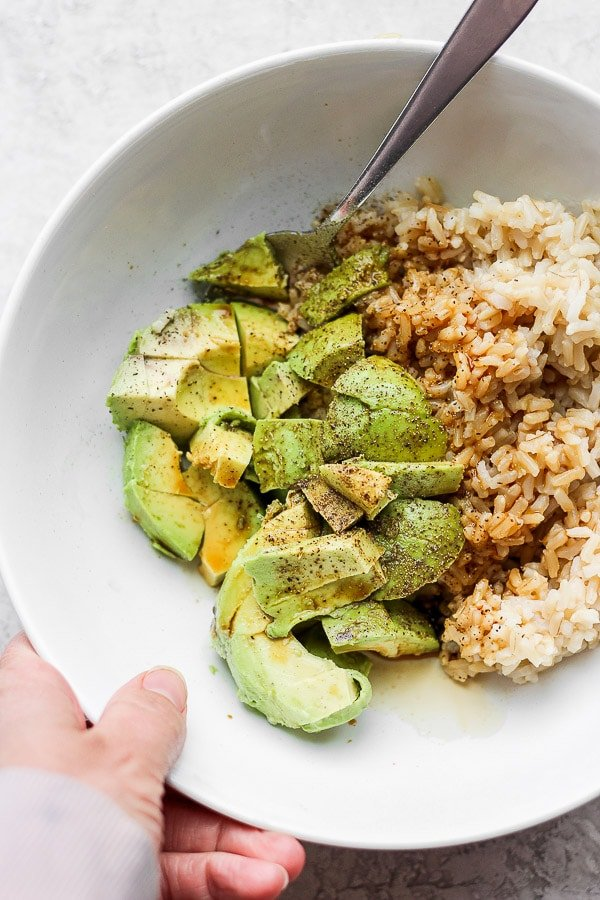 Avocado + Brown Rice Bowl - My favorite, simple go-to lunch/dinner that is amazing on its own, but feel free to add in some protein too! So many options!  Kid-friendly and perfect for a quick and easy weeknight dinner! (Dairy-free + GF) #brownricebowls #plantbasedrecipes #avocadorecipeshealthy #avocadorecipes #avocadobrownricebowls