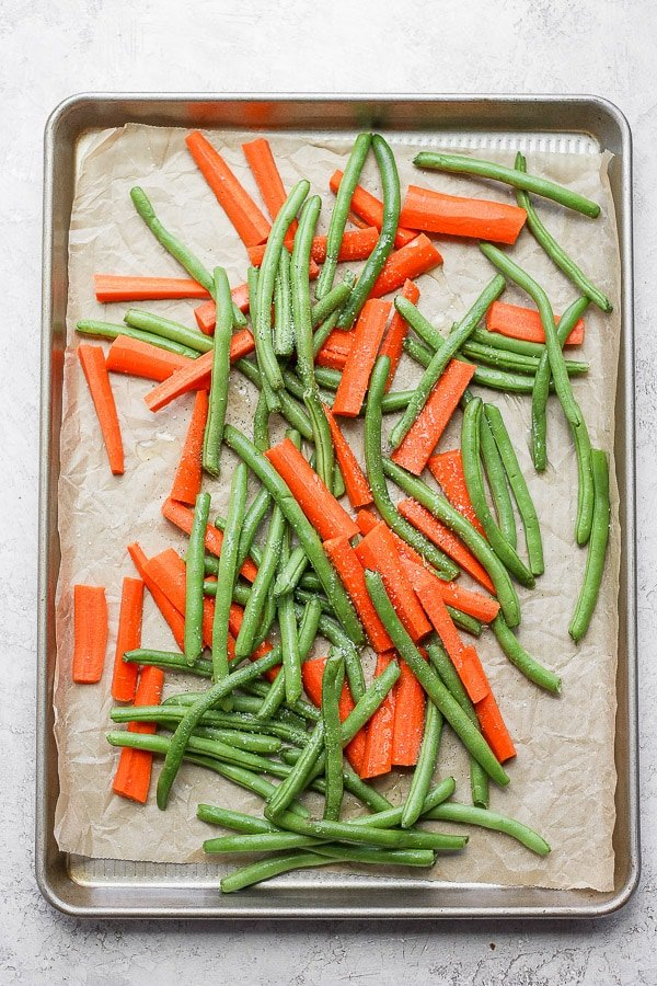 Veggies on cooking sheet ready to be roasted.