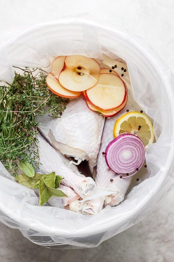 Raw turkey sitting in a brine.