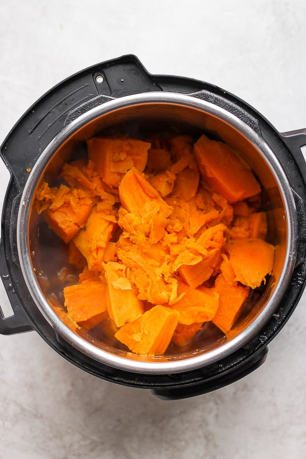 Cooked sweet potatoes that have been drained and returned to the InstantPot.
