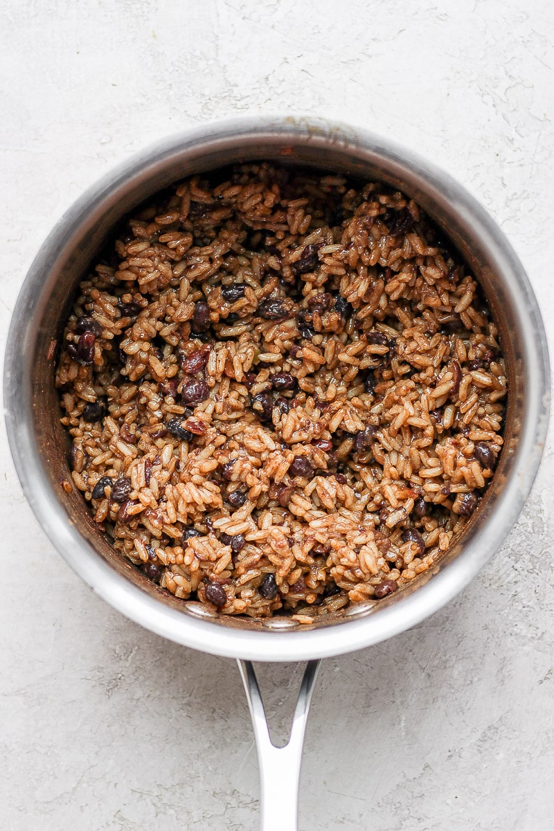 A pot with cooked black beans and rice inside.