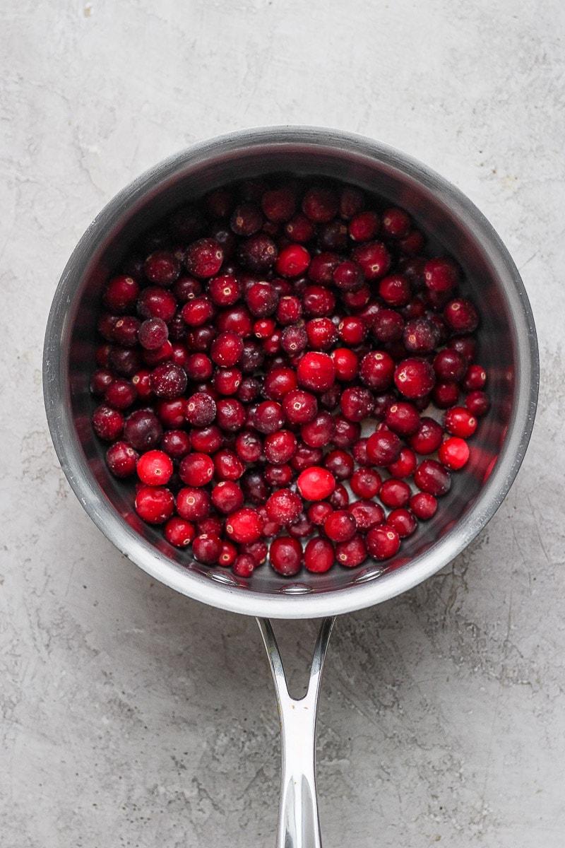 Cranberries in a medium saucepan.