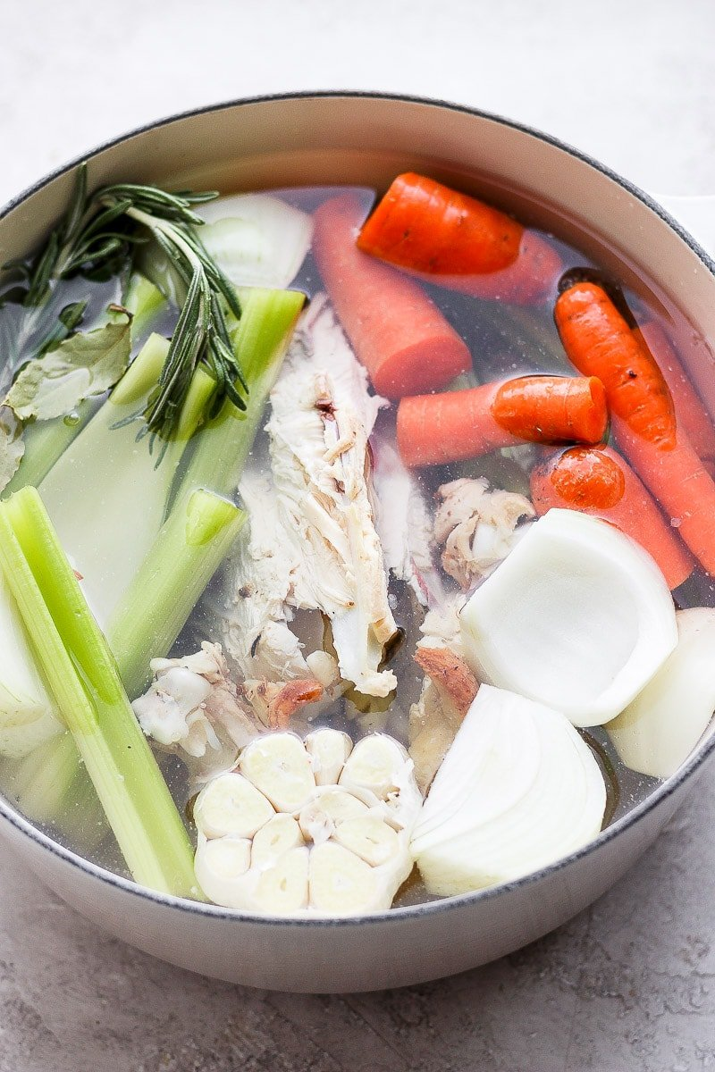 Ingredients for chicken broth in a large dutch oven.